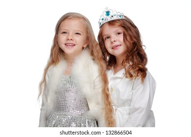 Adorable two little girls in beautiful dresses for Christmas on white background