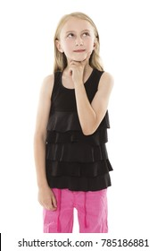 Adorable young blonde caucasian girl wearing a black top. The girl is isolated and smiling.