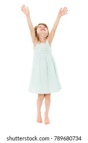 Adorable young blonde caucasian girl wearing a blue and white striped dress. The girl is isolated and smiling.
