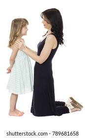 Adorable young blonde caucasian girl wearing a blue and white striped dress is with her mom.