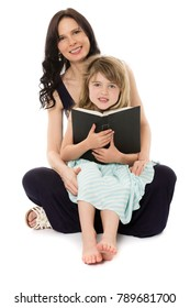 Adorable young blonde caucasian girl wearing a blue and white striped dress is with her mom. They are reading a book.