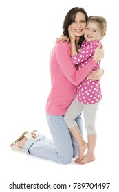 Adorable young blonde caucasian girl wearing a pink and white polkadot dress. The girl is with her mother.