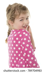 Adorable young blonde caucasian girl wearing a pink and white polkadot dress. The girl is isolated and smiling.