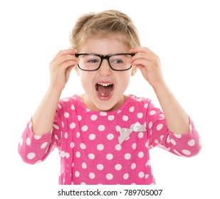 Adorable young blonde caucasian girl wearing a pink and white polkadot dress. The girl is playing with glasses.