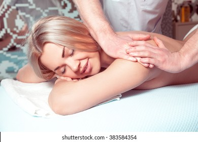 Adorable young blonde girl relaxing in spa massage salon. health, beauty, resort and relaxation concept. Beautiful blonde relaxing in spa.