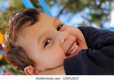 Adorable Young Boy having fun in the sunshine