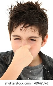 Adorable young boy making allergy stinky face expression over white.