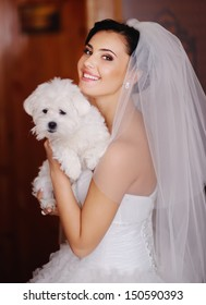 adorable young bride with a tiny dog at home