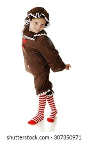"An adorable young elementary ""Gingerbread Girl"" twisting around with a smile in her dance.  On a white background."