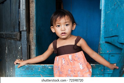 Adorable young girl living in poverty. Manila, Philippines.
