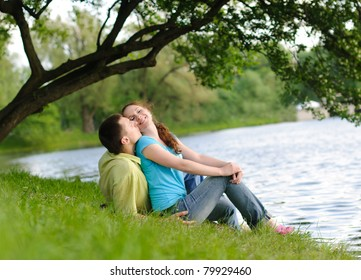 adorable young woman and man in the park