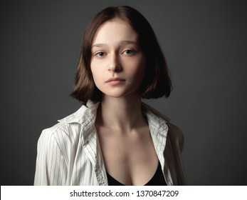 Adorable young woman in shirt.