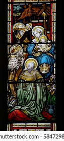 Adoration stained glass window A Victorian stained glass window showing the three Kings surrounding Saint Mary and the Christ child.  Over 100 years old, on public display in a church.