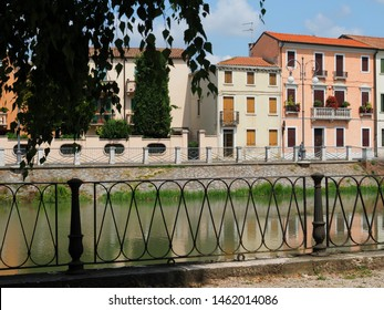 Adria, Italy. The Canal Bianco, waterway. The railing that runs along the riverbank.