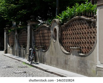 Adria, Italy. Giardino Scarpari, public park. Perimeter wall with bicycle. Originally the Scarpari family's garden, they were later purchased by the Municipality.