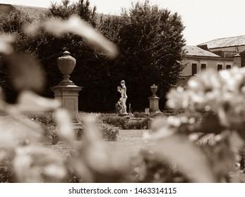 Adria, Italy. Giardino Scarpari, public park. Detail, fountain. Originally the Scarpari family's garden, they were later purchased by the Municipality. Sepia photo.