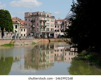 Adria, Italy - July 13, 2019. The Canal Bianco, waterway. Palaces on the river bank.