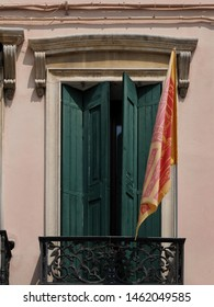 Adria, Italy - July 13, 2019. Window, balcony and the banner with the Lion of St. Mark, symbol of the Veneto Region.