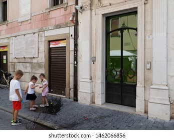 Adria, Italy - July 13, 2019. Historic centre. Children playing in the street.