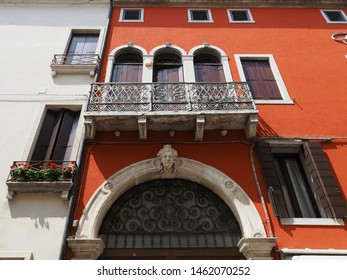Adria, Italy - July 13, 2019. Historic centre. Ancient red palace in venetian style. Entrance, balcony, windows.