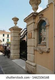 Adria, Italy - July 13, 2019. Villa next to Ponte Castello, seventeenth-century bridge rebuilt then in the nineteenth century. Detail, wayside shrine.