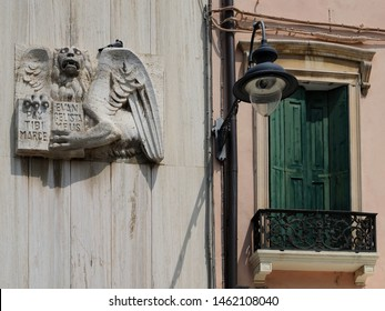Adria, Italy - July 13, 2019. Building facade, lion of Venice, lamppost and window.