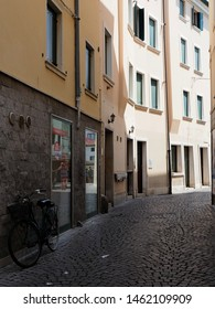 Adria, Italy - July 13, 2019. Old town, shady alley with bicycle.