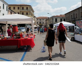 Adria, Italy - July 13, 2019. Flea market, people and stalls.