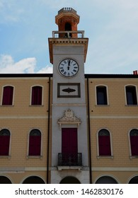 Adria, Italy - June 13, 2019. Ancient clock tower in the cathedral's square.