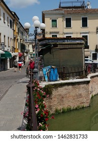 Adria, Italy - June 13, 2019. Old town, newsstand on the bridge over the Canalbianco river.