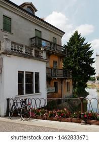 Adria, Italy - June 13, 2019. Bicycle on the bridge called Ponte Castello.