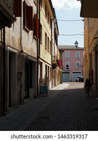 Adria, Italy - June 13, 2019. Historic centre, shady alley and colorful houses.
