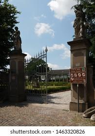 Adria, Italy - June 13, 2019. Giardino Scarpari, public park. Originally the Scarpari family's garden, they were later purchased by the Municipality. Open gate.