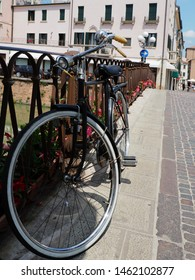 Adria, Italy. Ponte Castello, seventeenth-century bridge rebuilt then in the nineteenth century. A bicycle in the foreground.