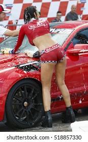 Adria, Rovigo, Italy - September 17, 2016: Show Beautiful bikini models wash a car race of Nascar Whelen Euro Series in Adria International Raceway.