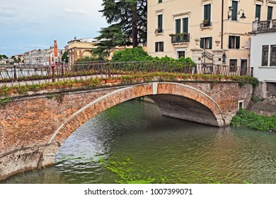 Adria, Rovigo, Veneto, Italy: ancient bridge over the river Canalbianco in the old town of the city near the Po Delta Park