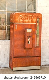 ADRIAN, TEXAS - AUGUST 25, 2013:  Photo of an old, rusty Coca-Cola vending machine manufactured by Vendo and telling us to Drink Coca-Cola in Bottles at ten cents each