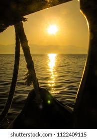 Adriatic Sea, Dalmatia, Croatia, May 27, 2018: View from motor sailer to the sunrise on the sea