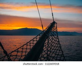 Adriatic Sea, Dalmatia, Croatia, May 28, 2018: View from motor sailer to the sunrise on the sea