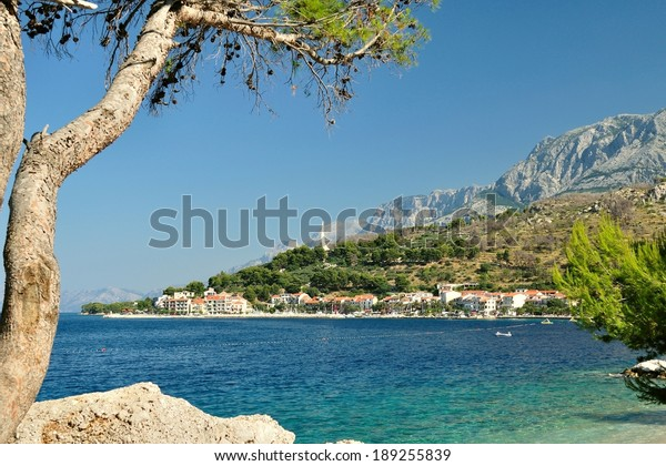 Adriatic sea at Podgora in Croatia with monument Seagull's wings and mountain Biokovo in background