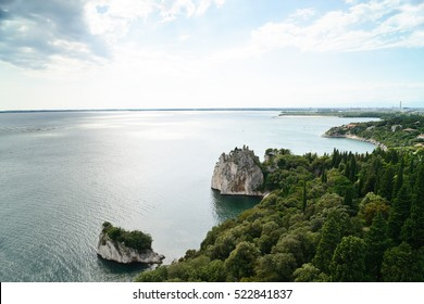 Adriatic sea with the ruins of the old Duino Castle near Trieste, Italy.