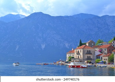 Adriatic sea surrounding old buildings with Venetian architecture in Perast, Montenegro