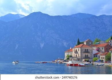 Adriatic sea surrounding old buildings with Venetian architecture in Perast, Montenegro