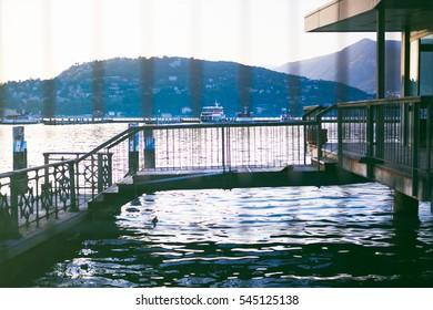 Adriatic Sea view of mountains on Como Lake through rod iron gates