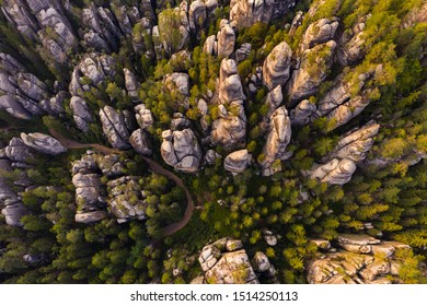 Adrspach rocks at sunset. Aerial top down view of trail path in rock formations, cliffs and trees of Adrspach Teplice rocks national park. Adrspach, Bohemia, Czech Republic, Czech mountains landscape.
