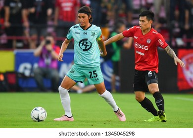 Adul Muensamaan (L) of Prachuap F.C.in action The Football Thai League match between SCG Muangthong United and PT Prachuap F.C.at SCG Stadium on February24,2019 in Nonthaburi, Thailand