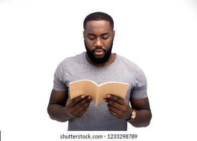 An adult African American man gets a second education at the university, prepares for entrance exams, reads scientific literature, focused and attentive. Image for advertising, isolated