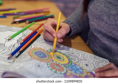 Adult antistress colouring book with colorful pencils