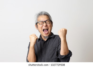 The adult Asian man on the white background.