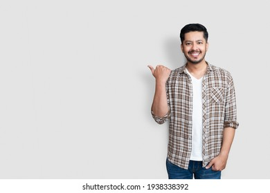 Adult asian man over isolated background smiling with happy face